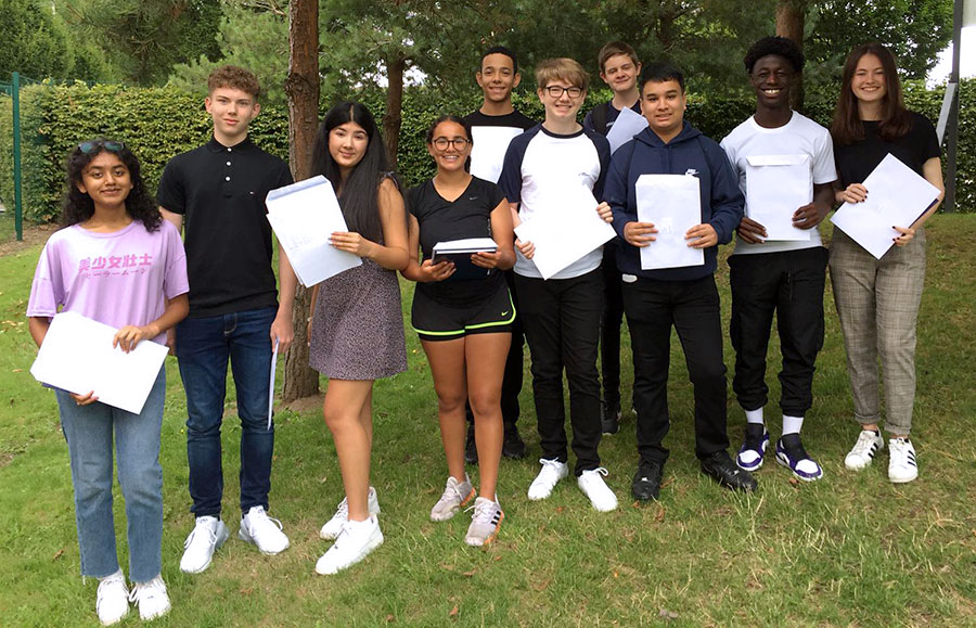 Photo of a group of students holding envelopes.