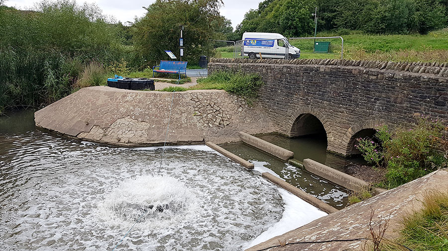 Photo of a water aerator operating in a lake.
