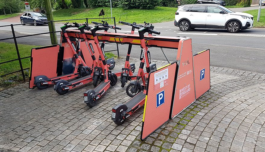 Photo of e-scooters parked in a rack.