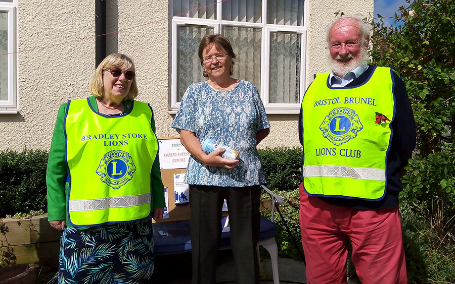 Photo of a group of three people, two wearing hi-vis tabards.