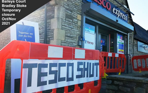 Photo of a large 'shut' sign in front of a shop.